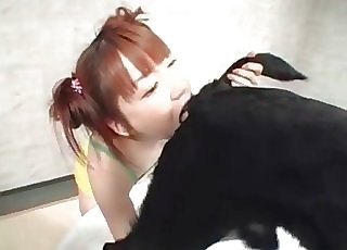 Redheaded Japanese girl slurps dog ass
